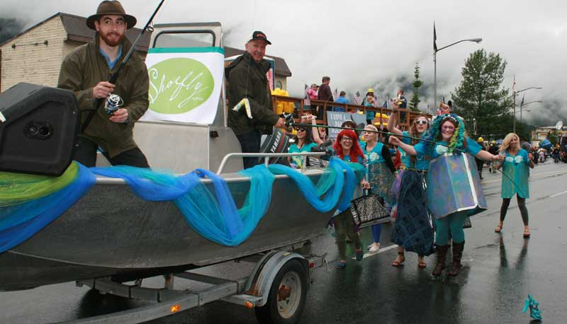 Shoefly mermaids chase the shoe bait while madly flinging candy to spectators at the annual July 4th Juneau Parade!