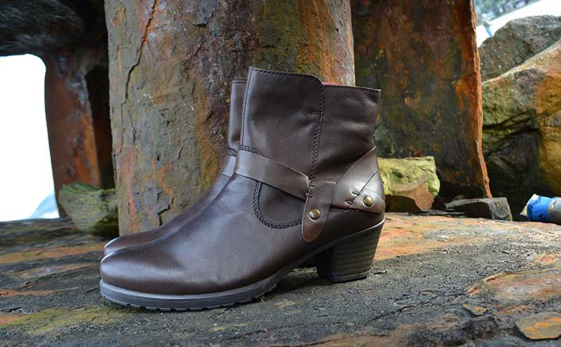 A taupe bootie with a zipper offers sophisticated comfort at Shoefly Alaska