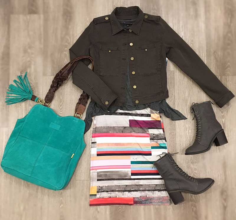 Modern striped skirt, super soft sweater, stretch denim jacket, teal handbag and grey lace-up boot combine in a fresh, polished small city look.